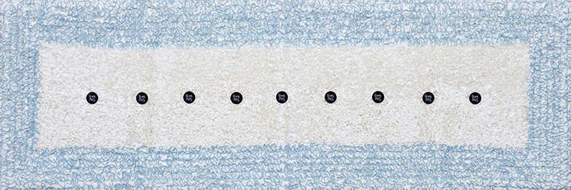 Nunca Más, objetos ensamblados; género bordado y metal, 60 cm x 176 cm. 2016