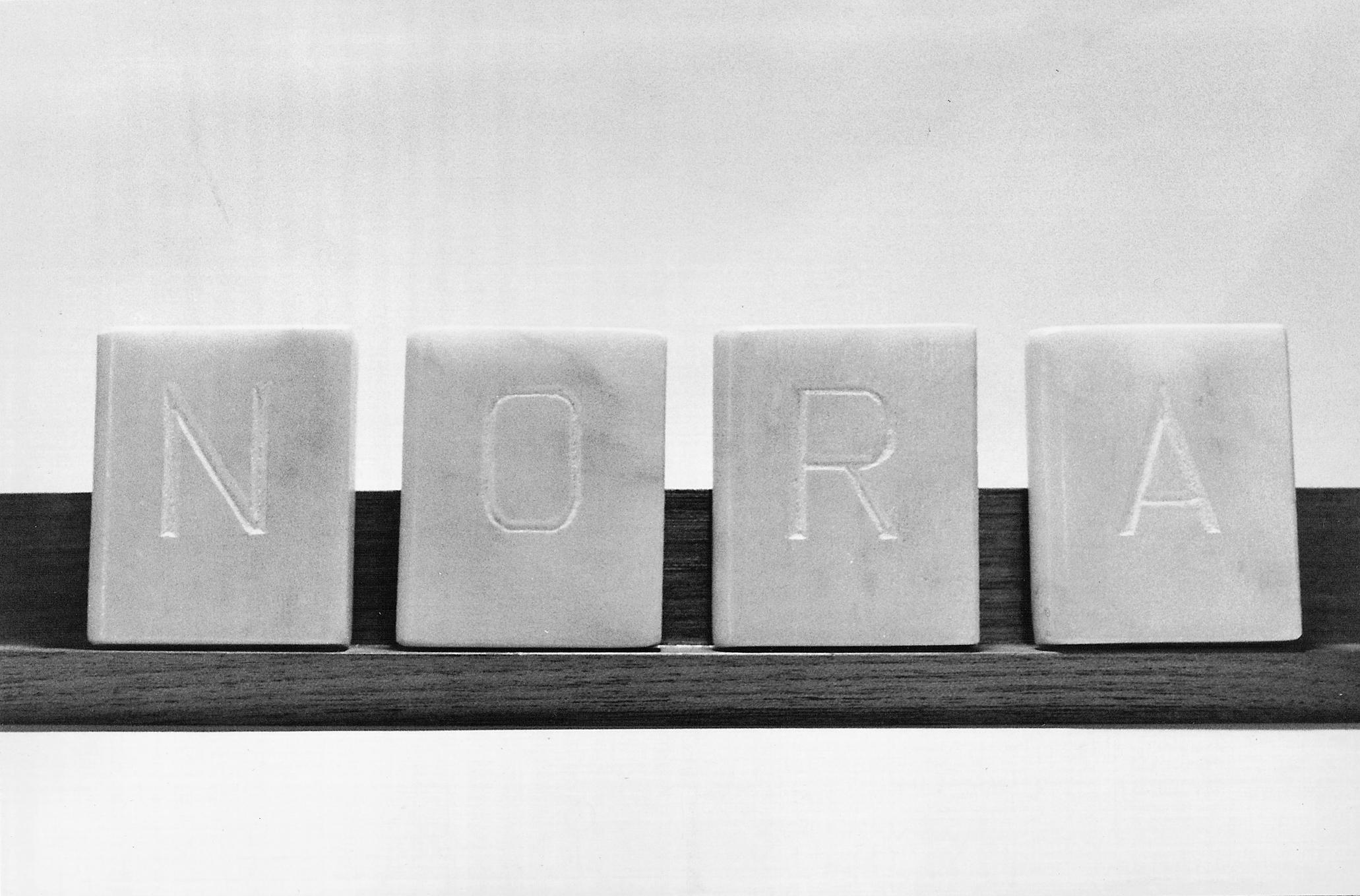 Abecedario, NORA, libros en mármol de Carrara 6 cm x 5 cm x 1,5cm, 1984